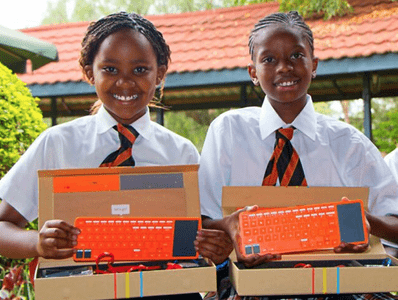 Children learning with Kano Computer Kit